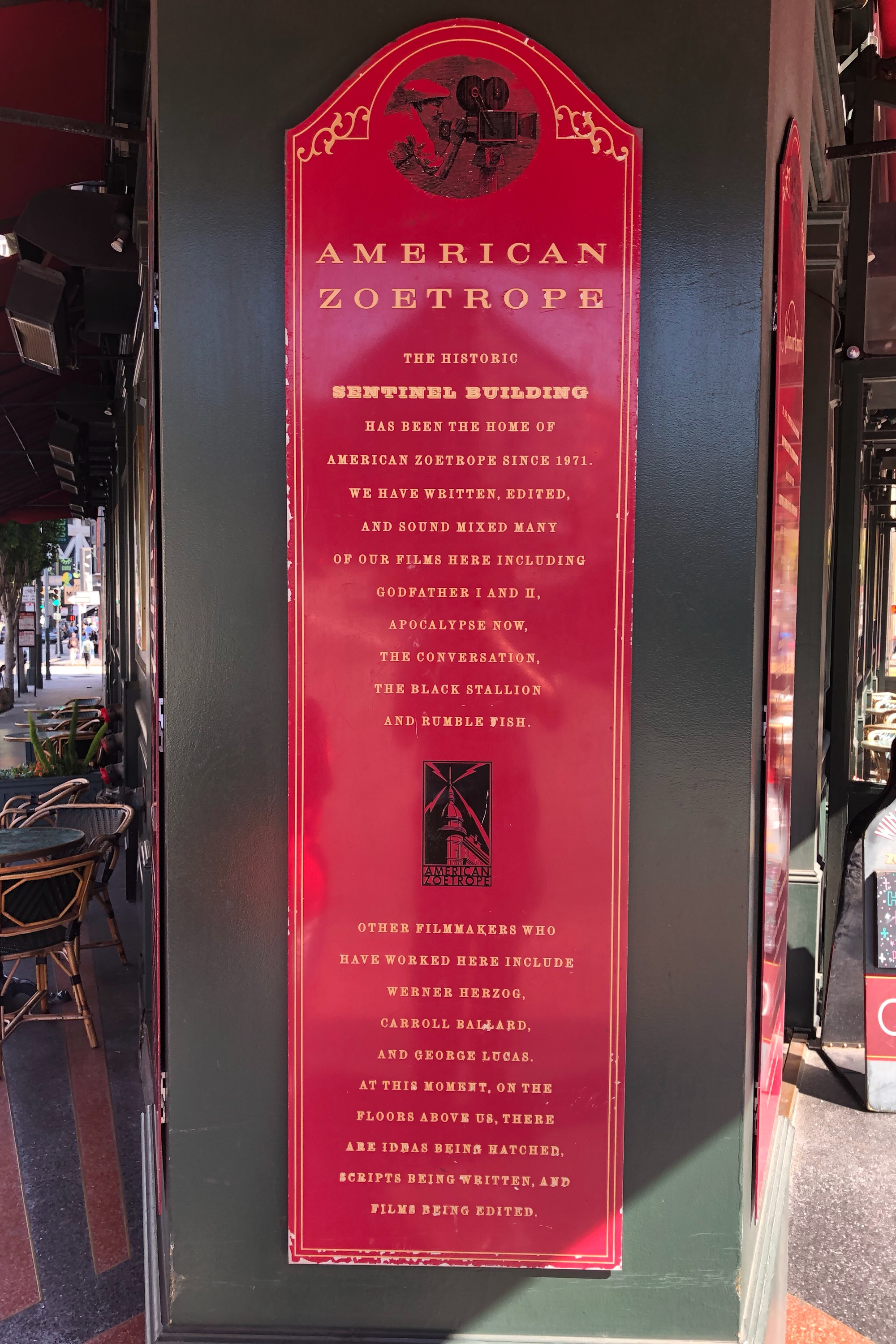 The historical plaque at the cafe entrance.